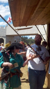 My Gregg holding a 6.5 foot sword on display/sale at one of the stalls.